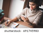 business woman using the smart... | Shutterstock . vector #691745983