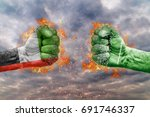 Two fist with the flag of United Arab Emirates and Saudi Arabia faced at each other ready for fight