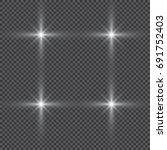 glowing lights effect  flare ... | Shutterstock .eps vector #691752403