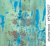 old blue painted wall with rust ... | Shutterstock . vector #691769227
