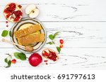 apple  pomegranate and honey ... | Shutterstock . vector #691797613