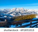 High Rocky Snowy Peak On Sunny...