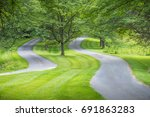 two winding roads with green... | Shutterstock . vector #691863283