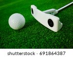 golf ball with putter on green...   Shutterstock . vector #691864387