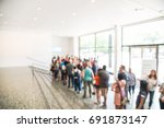blurred long people queuing at... | Shutterstock . vector #691873147