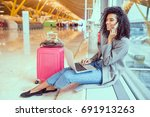 woman using mobile phone and... | Shutterstock . vector #691913263