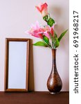 empty photo frame with flower...   Shutterstock . vector #691968217