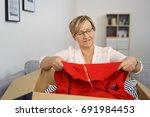 portrait of cheerful senior... | Shutterstock . vector #691984453