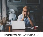 young sadness man with computer ... | Shutterstock . vector #691986517