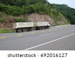truck transports freight on the ... | Shutterstock . vector #692016127