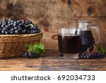 Small photo of Fresh aronia berries and aronia berry juice in glasses