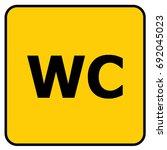 wc toilet sign yellow. vector. | Shutterstock .eps vector #692045023