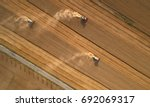 aerial view on three combine... | Shutterstock . vector #692069317
