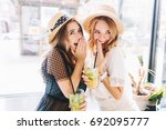 two enthusiastic ladies sharing ... | Shutterstock . vector #692095777