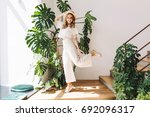 ecstatic blonde girl in white... | Shutterstock . vector #692096317