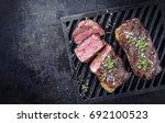 two barbecue dry aged kobe... | Shutterstock . vector #692100523