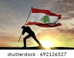 Lebanon flag being pushed into...