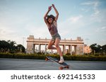 young sporty woman riding on... | Shutterstock . vector #692141533