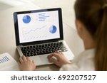 rear view at businesswoman... | Shutterstock . vector #692207527