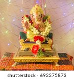 a ganesh puja at home. a... | Shutterstock . vector #692275873