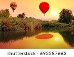 flying hot air balloons at... | Shutterstock . vector #692287663
