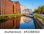 gray metal bridge over canal... | Shutterstock . vector #692288563