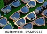 sunglasses on the counter of... | Shutterstock . vector #692290363