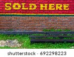 brick wall with sold wording... | Shutterstock . vector #692298223