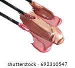 three shades of lip gloss on a...   Shutterstock . vector #692310547