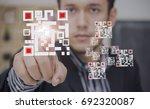 businessmen press qr code. | Shutterstock . vector #692320087