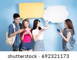 student use phone with speech... | Shutterstock . vector #692321173