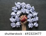 hand of a woman squeezing a... | Shutterstock . vector #692323477