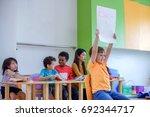 head of the class in preschool... | Shutterstock . vector #692344717