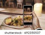 taking food photo  dinner food... | Shutterstock . vector #692350537