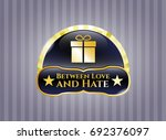 gold shiny badge with gift box ... | Shutterstock .eps vector #692376097