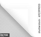 lower left paper corner with... | Shutterstock .eps vector #692399053