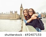 two teenage girls on big ben... | Shutterstock . vector #692407153