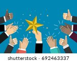 businessman holding up a star.... | Shutterstock .eps vector #692463337