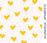 repeated cute hearts. polka dot.... | Shutterstock .eps vector #692485573