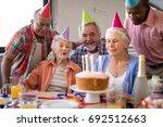 happy senior people wearing... | Shutterstock . vector #692512663