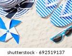 from above shot of beach items... | Shutterstock . vector #692519137