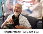 Portrait Of Smiling Senior Man...