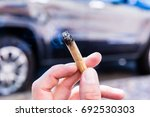 smoking a joint isolated  | Shutterstock . vector #692530303