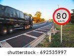 big truck passing on high speed ... | Shutterstock . vector #692535997