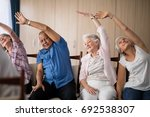 senior people stretching while... | Shutterstock . vector #692538307