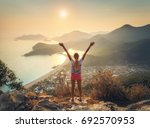 happy woman with raised up arms ... | Shutterstock . vector #692570953