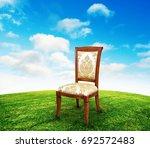 vintage chair on grass | Shutterstock . vector #692572483
