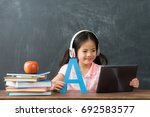 smiling young female kid... | Shutterstock . vector #692583577