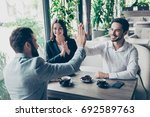 success and agreement between... | Shutterstock . vector #692589763