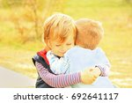 outdoors portrait of two cute... | Shutterstock . vector #692641117